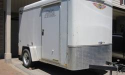 This 6 x 10 foot trailer was purchased from a dealer in the spring of 2011. It's in excellent condition, superior quality with no rivets to pop out. Floor is covered with rubber for superior floor. Used for only a short time until a truck was purchased.