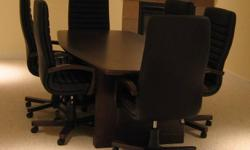 6ft Boardroom table mahogany color. Barely used. Second picture is of the color Chairs are sold separately.