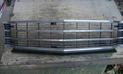 I AM SELLING AN ORIGINAL OEM GRILLE FOR 71-72 CHEVELLE   IT COMES COMPLETE DRESSED WITH THE CHROME AS WELL   IT HAS A FEW BLEMISHES ( 3 SMALL CRACKS ) ON THE INSIDE   THAT ARE NOT NOTICABLE AND SMALL CHIP ON OUTSIDE   OF A CORNER  CAN SEND MORE PICTURES