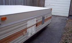 72 lional hard top camper sleeps 8 been stored inside till now has frige,,3burner stove sink and furnance spare wheel asking $800 if not sold i can get more in the spring no leaks it`s clean inside .can be set up on a nice sunny day  i have the owership