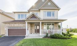 # Bath 4 MLS 1125056 # Bed 5 Are you looking for your family's next home but don't want to compromise on the upgrades? Stop right here! This contemporary 5 bedroom Gainsborough home by Minto highlights a gourmet eat-in kitchen, dark hardwood floors