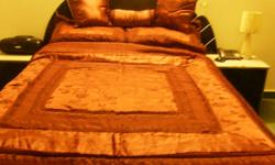I am offering a 7 piece queen bedroom set that includes headboard frame 2 side tables with 2 drawers each mirror dresser chest drawer *MATTRESS AND COMFORTER SET NOT INCLUDED Furniture has been kept in good hands Colour: Black Price: $300 If you are