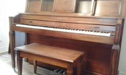"Looking for a good home! Baldwin, apartment size piano with matching hinged piano bench. The piano is 58"" wide, 45"" high and 25"" deep. Has been professionally tuned and maintained by a loving family."