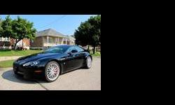 CALIBER AUTO LTD. IS EXCITED TO OFFER THIS GORGEOUS ASTON MARTIN VANTAGE COUPE, IT FEATURES THE NEW INTERIOR LAYOUT AND THE NEW 420HP ENGINE ? THIS CAR IS PRESENTED IN BLACK ON OBSIDIAN BLACK LEATHER WITH A TAN INSERT ? THIS IS A ONE OWNER CANADIAN CAR