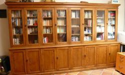 """Antique pine cupboard from 19C Quebec in pristine condition. Purchased several years ago for over $11,000. Cupboard stands 7' tall, 11' 9"""" wide. The lower portion is 18"""" deep and the upper portion 9"""" deep. The top can be separated from the bottom giving"""