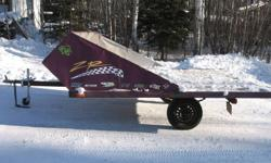 """Homebuilt double wide snowmobile trailer. Its was built in 1999. Has plywood deck all steel frame is still solid just surface rust, 13"""" rims with dodge hubs. Saltshield is Aluminum also homemade very solid works good. I haven't used it in 2 years so thats"""