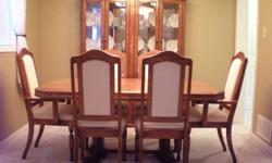 """9-piece oak dining room set in excellent condition.  Set includes:    Buffet (64""""w x 17""""d x 26""""h)    Hutch (60""""w x 16""""d x 55""""h)    Table (66"""" x 42"""")    Leaf (extends table to 90"""" x 42"""")    2 Arm Chairs    4 Chairs   Table easily extends on sliding rails."""
