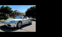 CALIBER AUTO LTD. IS EXTREMELY EXCITED TO OFFER FOR SALE THIS BEAUTIFUL FERRARI 360 SPIDER PRESENTED IN SILVER WITH A DARK BLUE INTERIOR - THIS CAR IS ALL ORIGINAL NO PREVIOUS DAMAGE OR ACCIDENT HISTORY - BOTH CARFAX AND CARPROOF VERIFIED - THIS CAR IS