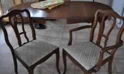 Nine Piece Dining Room Set Table with One Removable Leaf Six Chairs, One with Arms Tall Cabinet With Glass Doors and Three Shelves Lowboy Buffet Cabinet