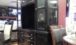 This set includes a beautiful black table with leaf, six chairs, and matching buffet and hutch. Two months old, paid $2800, a saving of $1300 for you makes this set attractive in both its stylish lines and as a great deal. For inquiries or to view the