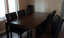 Selling one 9 piece dining room set. Set includes a maple espresso color table with two leaves and 6 espresso color faux leather chairs. Table does have some surface scratches in one spot and minor damage to side of one leaf. See pics for detail. Set is