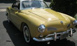 A Gorgeous 1969 Ghia refurbished to like new. 1/2 original paint,All original interior,Books & records from new, TURN KEY CAR!!! 705-742-9524 This car was refurbished using the EASY TILTER shown here. This unit is also for sale at 500.00