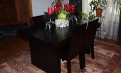 NEVER been USED -modern, sleek dining room table, buffet and chairs. Beautiful ebony table with 6 chairs and buffet. Solid peice of furniture.  Great peice of furniture.   SIZE -Table- Length 5ft./  Width 3 ft./ Height 2.5 ft. 4 drawers 6 chairs   SIZE -