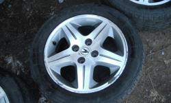 Set of four 1999-2000 Acura 1.6 EL Premium wheels with all centre caps, 4x100, with 195/55/15 Dunlop Signatures. 3 tires are about 70% while one is closer to 50%.   Rims are in good condition, about 8/10. Located in Oshawa, call or text 647 457 9899 with