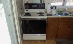 This stove is light cream colour. Large window on oven door. Clock, program cooking time etc.oven light & stove top light. Great condition, large bottom storage drawer. Asking $135.00 or best resonable offer. Purchaser to pick up