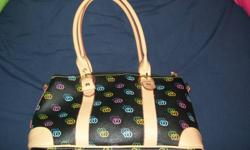 """Asking $15 or best offer!! Black in colour with """"CC"""" written in various colours 2 inside pockets, one is zipper the other is perfect fit for a cell phone Lots of room on inside of purse, """"minicci"""" is written on inside 2 Handles which are adjustable in"""