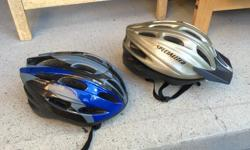 Two Hi-quality bike helmets 1) LEFT, Raleigh Child's Helmet -- SOLD -- $20 2) RIGHT, Specialized Air Wave Adult's Helmet -- SOLD -- $25 Both in perfect condition, multi-adjustable - Have several others, various sizes (not pictured), lower priced than
