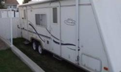 This trailer offers Island Queen size bed with door to outside, pull out for extra room and a very open floor plan, couch and table make down to offer additional sleeping, kitchen at back of trailer beside 2nd door to outside, large two door fridge, lots