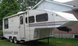 24' Shadow Cruiser 5th wheel trailer - includes hitch ($1000 value) Fridge, stove, microwave airconditioning furnace awning large master sleeping area bathroom with shower lots of cupboards kept in excellent condition will entertain reasonable offers