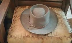 Features: Imperial Quality Made from Akubra's Imperial Quality Pure Fur Felt Reeded Roan Leather Sweatband. Made in Australia Water Resistant Brim: 70mm Cut Edge Crown Height: 90mm Barramundi Leather Hat Band *** sizing head circumference 21 5/8 in. or 55