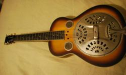 Very good condition dobro guitar. Comes with soft case for travel. Great sound and quality wood. Square neck and has steel slide and picks.