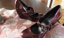 Size 38 (7) Deep red (cranberrry) patent leather wedge shoes with strap. Very different ! CUTE! Worn a few times (like new). Paid $110 Downtown, Ottawa Price is firm.