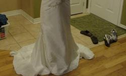 Beautiful wedding gown. Worn once. Very lightweight, perfect for anytime of the year. Fits aprox size 6 as it was fitted. Room to take out a size or easily tailored to be smaller. Paid $1100 for it 8 mths ago. Paid 180 for it to be dry cleaned. no tears