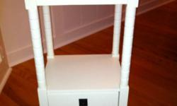 Just like new - only a few months old. Telephone table height, in a creamy white colour. Paid $99 plus tax. Asking $65. This ad was posted with the Kijiji Classifieds app.