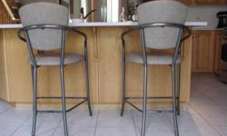 "I'm selling two Amisco kitchen counter / breakfast bar stools. The metal has a pewter-like finish to it, and the cushions are upholstered in a light-brown leatherette. Both stools are in excellent condition. Dimensions: - Seat height is 25"". - Cushions"