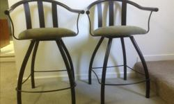 """Amisco Swivel Bar Stools """"Chiller"""" 2 stools for $100.00 (original price was $340 for the pair) Black, metal frame, swivel seats, and foot rests. The back is curved and comfortable. Seat cover fabric is """"Moss"""" (seat easily comes off with four screws so it"""