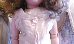 """ANTIQUE 21"""" ARMAND MARSEILLE #390 GERMAN BISQUE DOLL.  SHE IS IN EXCELLENT CONDITION WITH NO DAMAGE TO COMPOSITION BALL JOINT BODY OR BISQUE HEAD.  SHE HAS BLUE SLEEP EYES WITH LASHES AND COMES WITH AN ANTIQUE DRESS, UNDERCLOTHES, SOCKS AND SHOES. SHE HAS"""