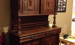 """OVer 100 years old. Belgium Mechelen style hutch! Likely made of walnut. The hutch is actually three parts (bottom, middle """"rack"""" and top) for easy assembly. We can assist with delivery in the Victoria - Cowichan area. Payment in cash or certified cheque"""