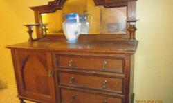 Beautiful, solid oak buffet / hutch purchased in England. Striking patina, hand cut dovetail drawers. (slight crack in mirror - can be repaired). You pick up (sorry, no delivery available).
