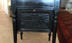 Rustic antique cabinet with leather tooling on door and both sides. MOVING SALE. Interested buyers must purchase by July 14.