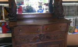 Beautiful Antique Cabinet. Storing it in our garage as there are no walls left for it in our house.