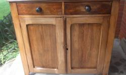 Up for sale is this smaller size antique cupboard made of a variety of hardwoods chestnut, basswood & elm. Circa 1880. Good and solid all around with square nail construction.   Two doors with shelves inside with two drawers that are hand dovetailed.