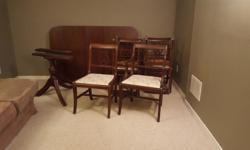 Antique dinning room set for sale. Seats 6; Chairs included. Leaf included. All original craftsmanship. Refinishing & re-upholstering required to update the style. Asking price: $375.00. Negotiable. Serious buyers only please.