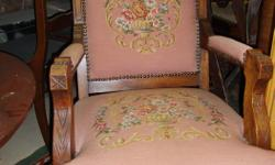 Antique Eastlake Walnut Arm Chair , Needle point cover Orginal, finish Great condition with Brass castors Circa 1860 299.00 At COLLECTOR'S II - 621 Johnson Street Wed to Fri. 10-545 Sat. 10-5 Sun 12-4 Ph 250 383 0003