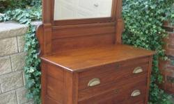 This handsome Victorian Eastlake dresser was crafted in the late 1800s, and is as sturdy as the day it was built! It features reeded side columns and drawer fronts, dovetail construction, and a nicely bevelled swing mirror. Small castors make it easy to