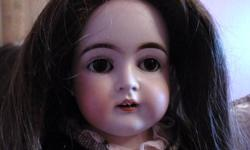 """ANTIQUE GERMAN 23"""" KESTNER BISQUE DOLL #148.  THIS IS A LESS COMMON DOLL.  SHE HAS NO DAMAGE TO HER BISQUE HEAD.  SHE HAS BROWN SLEEP EYES AND A LEATHER BODY WITH BISQUE HANDS.  SHE COMES WITH A VINTAGE PEACH DRESS THAT FITS HER PERFECTLY, AN ANTIQUE"""
