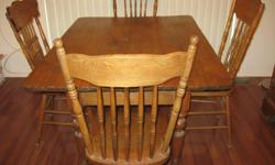 """Solid wood antique kitchen table and four vintage mismatched pressback chairs. In excellent used condition. The table measures 38""""x51"""". Price is firm. Cash only. No delivery. Pickup in Nepean near Greenbank and Hunt Club."""