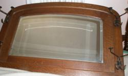 This is a beautiful, quality oak hall mirror that is in excellent condition. The frame measures 25 in. high and 38 in. wide. The mirror has a one inch bevelled edge and the frame is quarter sawn oak. The frame is five inches wide and one inch thick. The