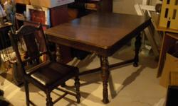 1920's antique oak table and 4 matching chairs.  all in perfect condition. leather seats. hide-away fold out leaf.  don't make them like this any more. call John 705 325 0039  Orillia