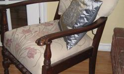 Unique. Solid, carved wood arms and legs. Upholstered back and seat. Very comfortable. Useful in many rooms of your home-dining, bedroom, living room. Good condition, non-smoking home. Please call 435-3611 or e-mail. See my other ads. Thanks