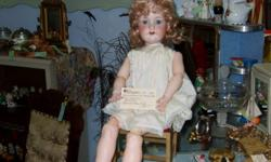 Armand Marseille Ball Jointed Porcelain Doll With teeth & sleepy Eyes. Made in Germany 1885 - 1930's. She is in great shape. Come see what else you might find at McRatterson's Collectibles & Antiques in the center of Kintore at the flashing red light.