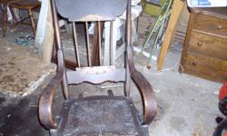 This early rocker is from an estate in Vittoria.  Original finish and in very good condition.  Just needs a good cleaning or you can refinish it if you like.