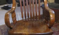ANTIQUE    ROCKING  CHAIR                                                VERY OLD CHAIR I BELIEVE LATE 1800's VERY ORNATE . I HAD IT PROFESIONALLY STRIPPED DOWN AND REDONE. THE WOOD  I CAN BEST TELL IS ASH. ON ROCKING CHAIRS THE OLDER ONES SEAT WHERE