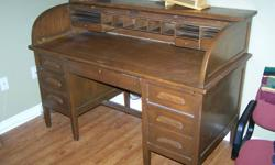 This is a solid wood antique roll top desk with a removal cubby hole section for storing items.  I'm moving to a smaller home so this is one of the items available for sale.  The condition is good.  Asking $250.00.  Call or email questions.