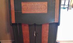 """Solid Oak antique secretary desk with lots of character has carvings on top bottom and front of desk and front of doors below desk. 48""""high by 28'wide by 13'deep. Lots of cubbies inside the desk area. Asking $170obo. Check out our other ads too."""