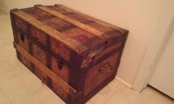 """This is a small old trunk made of wood and leather. 24""""wide 15""""deep and 14"""" high Asking $80 obo"""